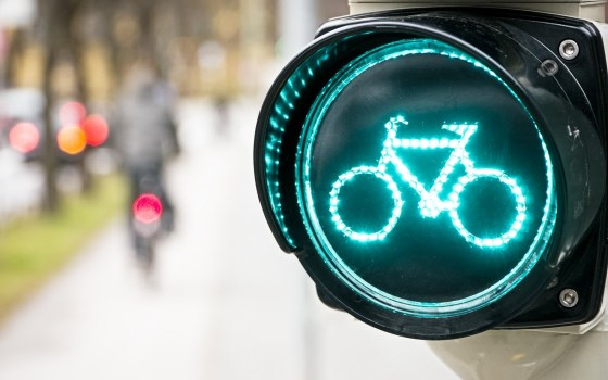 Photo Source: http://freehdwalls.net/city-road-sign-bicycle-lights-bokeh-hd-wallpaper/